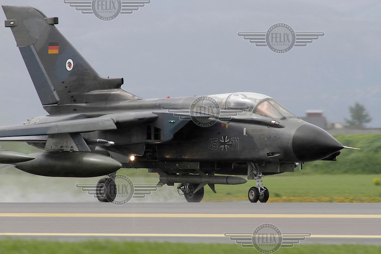 A German Tornado fighter jet is taking off. Nato Tiger Meet is an annual gathering of squadrons using the tiger as their mascot. While originally mostly a social event it is now a full military exercise. Tiger Meet 2012 was held at the Norwegian air base Ørlandet.