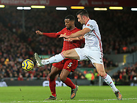 2nd January 2020; Anfield, Liverpool, Merseyside, England; English Premier League Football, Liverpool versus Sheffield United; Georginio Wijnaldum of Liverpool and Enda Stevens of Sheffield United compete for the ball - Strictly Editorial Use Only. No use with unauthorized audio, video, data, fixture lists, club/league logos or 'live' services. Online in-match use limited to 120 images, no video emulation. No use in betting, games or single club/league/player publications