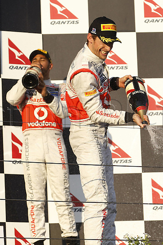 18.03.2012. Melbourne, Australia.   FIA Formula One World Championship 2012 Grand Prix of Australia 3 Jenson Button GBR Vodafone McLaren Mercedes  sprays champagne from the podium Jenson Button won the race with Sebbastian Vettel in second and Lewis Hamilton in third place.