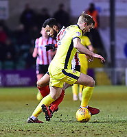 Lincoln City's Matt Green vies for possession with Cheltenham Town's Jamie Grimes<br /> <br /> Photographer Andrew Vaughan/CameraSport<br /> <br /> The EFL Sky Bet League Two - Lincoln City v Cheltenham Town - Tuesday 13th February 2018 - Sincil Bank - Lincoln<br /> <br /> World Copyright &copy; 2018 CameraSport. All rights reserved. 43 Linden Ave. Countesthorpe. Leicester. England. LE8 5PG - Tel: +44 (0) 116 277 4147 - admin@camerasport.com - www.camerasport.com