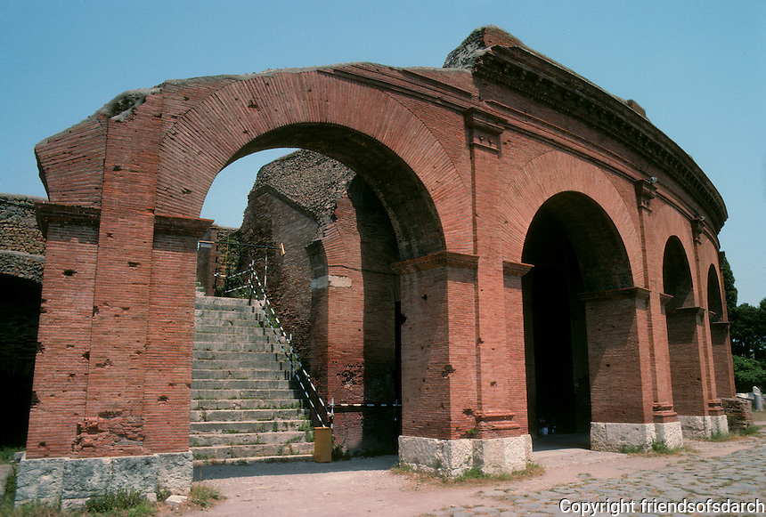 Italy: Ostia--Theater (much restored). Probably built during Reign of Augustus, but bright red brickwork. Time of enlargement, Septimius Severus. Photo '83.