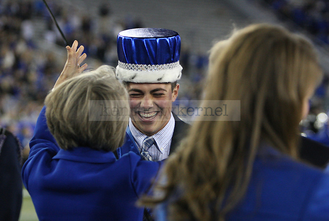 Biosystems engineering senior Alexander Wade, left, is crowned by Dr. Mary Lynne Capilouto during halftime of the University of Kentucky Homecoming football game against Alabama State at Commonwealth Stadium in Lexington, Ky., on Saturday, November 2, 2013. Photo by Tessa Lighty | Staff