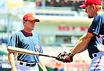 4 July 2010: Washington Nationals batting coach Rick Eckstein (left) gives instruction to pitcher Stephen Strasburg prior to a game against the New York Mets at Nationals Park in Washington, DC. The Mets defeated the Nationals 9-5 in the fourth game and splitting their 4-game series. Mandatory Credit: Ed Wolfstein Photo