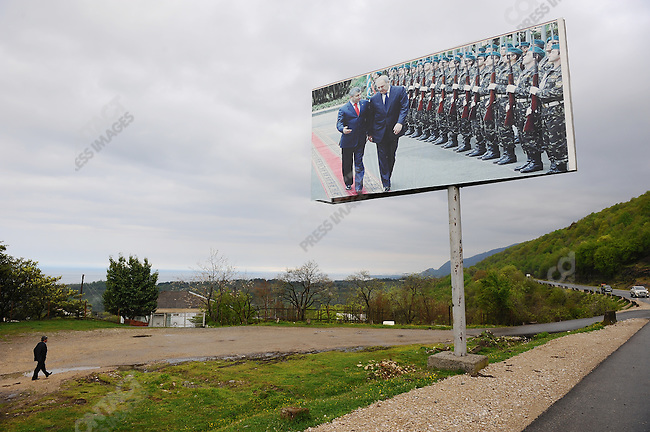 Along the main road to Sukhumi from the Russian border a poster showing the presidents of Abkhazia and South Ossetia, the two republics that have split from Russia, inspecting a guard of honour. Abkhazia, April 29, 2009