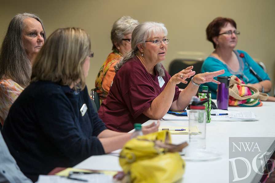 STAFF PHOTO ANTHONY REYES &bull; @NWATONYR<br /> Linda Bertalotto, with the Veterans Administration Mental Health Consumer Council, talks about a few issues she sees while trying to help veterans Thursday, August 21, 2014 during a breakout session at the Veterans Health Care System of the Ozarks'  Mental Health Summit at the Jones Center in Springdale. This session focused on spouse and family support for veterans. The summit brought together several agencies to improve treatment for veterans and their families. There was a small job fair at the end of the summit for veterans.
