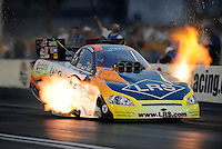 Oct. 31, 2008; Las Vegas, NV, USA: NHRA funny car driver Tim Wilkerson launches off the starting line during qualifying for the Las Vegas Nationals at The Strip in Las Vegas. Mandatory Credit: Mark J. Rebilas-