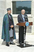 Washington, DC - June 14, 2004 -- United States Secretary of Defense Donald H. Rumsfeld (right) talks to reporters during a media availability with President Hamid Karzai of Afghanistan (left) following their meeting in the Pentagon in Washington, D.C. on June 14, 2004.                                  .Credit: Robert D. Ward / DoD via CNP
