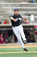 Wake Forest Demon Deacons third baseman Will Craig (22) makes a throw to first base against the Florida State Seminoles at Wake Forest Baseball Park on April 19, 2014 in Winston-Salem, North Carolina.  The Seminoles defeated the Demon Deacons 4-3 in 13 innings.  (Brian Westerholt/Four Seam Images)