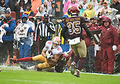 San Francisco 49ers tight end George Kittle (85) is tackled by Washington Redskins cornerback Quinton Dunbar (23) in first quarter action at FedEx Field in Landover, Maryland on Sunday, October 20, 2018.  Also pictured is Washington Redskins strong safety Montae Nicholson (35).  The 49ers won the game 9 - 0.<br /> Credit: Ron Sachs / CNP