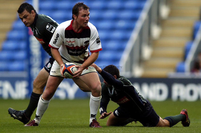 Photo: Jonathan Butler..London Irish v Saracens. EDF Anglo-Welsh Cup. 30/09/2006..Glen Jackson of Saracens is tackled.