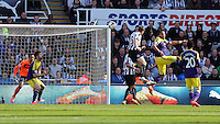 Pictured: Dan Gosling of Newcastle (3rd R) has his header challenged by Ashley Williams of Swansea (2nd R). Saturday 19 April 2014<br />