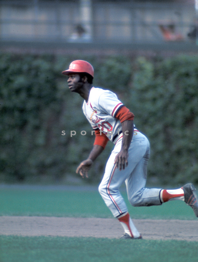 St. Louis Cardinals Lou Brock (20) in action during a game at Wrigley Field, in Chicago, Illinois. Lou Brock played for 19 years and was inducted to the Baseball Hall of Fame in 1985.