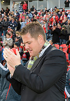 17 October 2009: Toronto FC head coach Chris Cummins shows his support for the fans during an MLS game between Toronto FC and Real Salt Lake at BMO Field in Toronto..Toronto FC won 1-0..