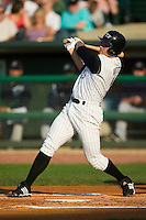 Louisville first baseman Joey Votto (5) follows through on his swing versus Charlotte at Louisville Slugger Field in Louisville, KY, Tuesday, June 5, 2007.