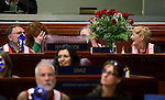 Sheree Rosevear, secretary for Assemblyman John Hambrick, R-Las Vegas, reacts to a gift of flowers on the Assembly floor session at the Legislative Building in Carson City, Nev., on Wednesday, April 24, 2013. .Photo by Cathleen Allison