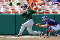 Second Baseman Michael Broad #8 swings at a pitch during a  game against the Clemson Tigers at Doug Kingsmore Stadium on March 31, 2012 in Clemson, South Carolina. The Tigers won the game 3-1. (Tony Farlow/Four Seam Images).
