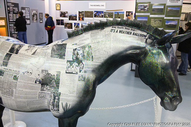 A fiberglass horseondisplay in the Roswell UFO Museum  is decorated with headlines from the past about the 1947 Roswell UFO Incident.
