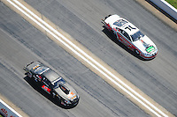 Apr. 28, 2012; Baytown, TX, USA: Aerial view of NHRA pro stock driver Erica Enders (left) alongside Mike Edwards during qualifying for the Spring Nationals at Royal Purple Raceway. Mandatory Credit: Mark J. Rebilas-