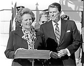 Washington, DC - (FILE) -- Prime Minister Margaret Thatcher of Great Britain, left, makes a statement following their 2 hour meeting as United States President Ronald Reagan, right, listens in outside the Diplomatic Entrance of the White House  in Washington, D.C. on Wednesday, February 20, 1985.  Mrs. Thatcher was in Washington for two days of talks with high administration officials..Credit: Arnie Sachs / CNP