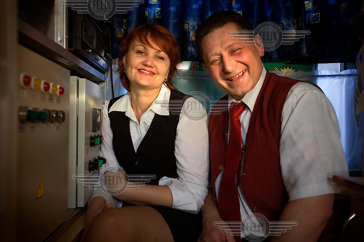 Train conductors on a train across Russia. The Trans-Siberian Express travels through German, Polish and Belarusian territories to arrive in the Siberian city of Irkutsk. The entire journey takes six days.