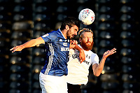 10th July 2020; Craven Cottage, London, England; English Championship Football, Fulham versus Cardiff City; Callum Paterson of Cardiff City competes for a header with Tim Ream of Fulham