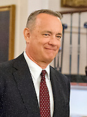 Actor and filmmaker Tom Hanks arrives to accept Presidential Medal of Freedom, the Nation's highest civilian honor, from United States President Barack Obama in the East Room of the White House in Washington, DC on November 22, 2016.<br /> Credit: Ron Sachs / CNP