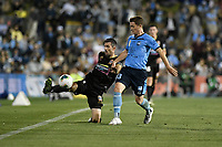 1st November 2019; Leichhardt Oval, Sydney, New South Wales, Australia; A League Football, Sydney Football Club versus Newcastle Jets; Jason Hoffman of Newcastle Jets tries to keep the ball in play as Brandon O'Neill of Sydney approaches - Editorial Use