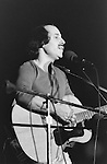 October 24 1975, Paul Simon performing at Seton Hall University and Playing guitar, Side View