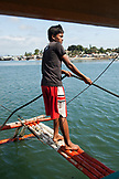 PHILIPPINES, Palawan, Puerto Princessa, portrait of a fisherman in front of his boat in the City Port Area