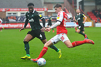 Fleetwood Town's Ryan Rydel competes with Plymouth Argyle's Yann Songo'o<br /> <br /> Photographer Richard Martin-Roberts/CameraSport<br /> <br /> The EFL Sky Bet League One - Fleetwood Town v Plymouth Argyle - Saturday 16th March 2019 - Highbury Stadium - Fleetwood<br /> <br /> World Copyright © 2019 CameraSport. All rights reserved. 43 Linden Ave. Countesthorpe. Leicester. England. LE8 5PG - Tel: +44 (0) 116 277 4147 - admin@camerasport.com - www.camerasport.com