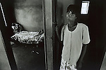 UPINGTON, SOUTH AFRICA - FEBRUARY 8: A person stands near the entrance to a room February 8, 2002 in Loisevale near Upington, South Africa. The bed in the room is the location where Baby Thsepang, an 8-month-old baby was raped by her father in October 2001. Loisevale is a poor and destitute black township where unemployment is high and a number of social problems including domestic violence and alcohol abuse exists. The baby rape shocked the country and it is struggling with an increasing number of rapes and sexual abuse of young children. The country has the highest number of rapes in the world. (Photo by Per-Anders Pettersson)