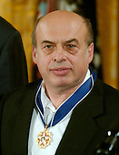 "Washington, D.C. - December 15, 2006 -- Natan Sharansky  wears the Presidential Medal of Freedom after receiving it  from United States President George W. Bush and first lady Laura Bush during a ceremony in the East Room of the White House on Friday, December 15, 2006.  The medal is the nation's highest civil award.  It may be awarded ""to any person who has made an especially meritorious contribution to (1) the security or national interests of the United States, or, (2) world peace, or (3) cultural or other significant public or private endeavors"".   Natan Sharansky's life is the story of good conquering evil and an illustration of the strength of the human spirit.  Imprisoned by the Soviet regime for his work to advance religious liberty and human rights, he spent nine years in the gulag.  Following his immigration to Israel, he served with distinction in that nation's government.  He remains a powerful champion of the principles that all people deserve to live in freedom and that the advance of liberty is critical to peace and security around the world.  The United States honors Natan Sharansky for his contributions to and sacrifices for the cause of democracy and freedom.<br /> Credit: Ron Sachs / CNP"