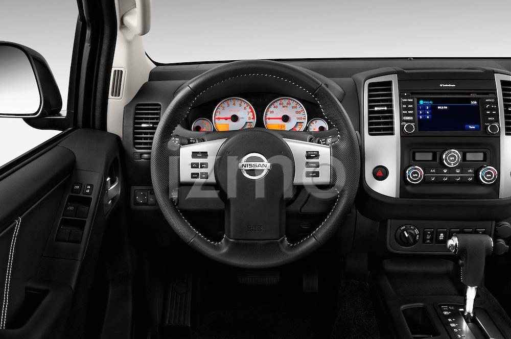 Car pictures of steering wheel view of a 2016 Nissan Frontier PRO-4X-Crew-Cab 4 Door Pickup Steering Wheel
