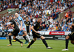 Aaron Mooy of Huddersfield Town scores the first goal during the premier league match at the John Smith's Stadium, Huddersfield. Picture date 20th August 2017. Picture credit should read: Simon Bellis/Sportimage