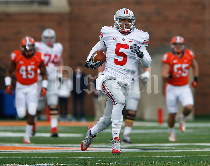 Ohio State Buckeyes quarterback Braxton Miller (5) runs for a TD in first quarter action at Memorial Stadium in Champaign, Illinois on November 16, 2013.  (Chris Russell/Dispatch Photo)