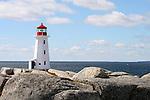 Images of The Canadian Maritime Provinces of Nova Scotia and Prince Edward Island. Lighthouse at Peggy's Cove, Nova Scotia, Canada.