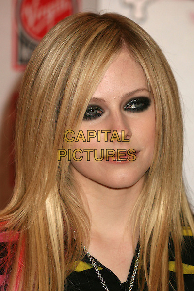 "AVRIL LAVIGNE.Avril Lavigne ""The Best Damn Thing"" CD Signing at the Virgin Megastore, Hollywood, California, USA..Byron Purvis/AdMedia .April 19th, 2007.headshot portrait eyeliner make-up make up make-up .CAP/ADM/BP.©Byron Purvis/AdMedia/Capital Pictures"
