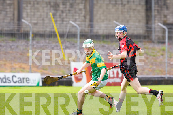 Kilmoyley's Daniel Collins and Kenmare/Kilgarvan's David Crowley in action in the senior hurling championship at Austin Stack park, Tralee.