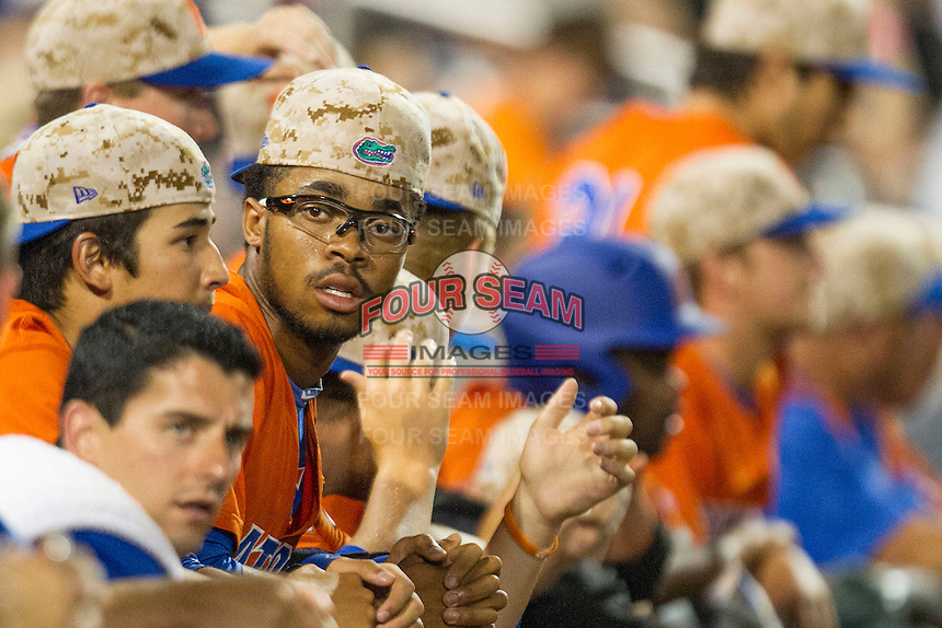 Florida Gators outfielder Buddy Reed (23) in the dugout during Game 13 of the NCAA College World Series against the Virginia Cavaliers on June 20, 2015 at TD Ameritrade Park in Omaha, Nebraska. The Cavaliers beat the Gators 5-4. (Andrew Woolley/Four Seam Images)