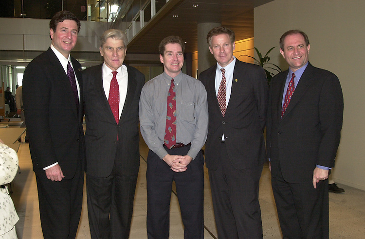 RC20000228-513-IW: February 28, 2000: The Virginia Republican delegation with reporter Wayne Campbell from left fmr. Gov. George Allen, Sen. John Warner, Campbell, Rep. Tom Davis and Gov. Jim Gilmore at America Online headquarters.                Ian Wagreich/Roll Call