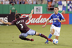 July 22 2007:  Facundo Erpen (3) of the Rapids attempts a slide tackle on Davy Arnaud (22) of the Wizards.  The MLS Kansas City Wizards tied the visiting Colorado Rapids 2-2 at Arrowhead Stadium in Kansas City, Missouri, in a regular season league soccer match.