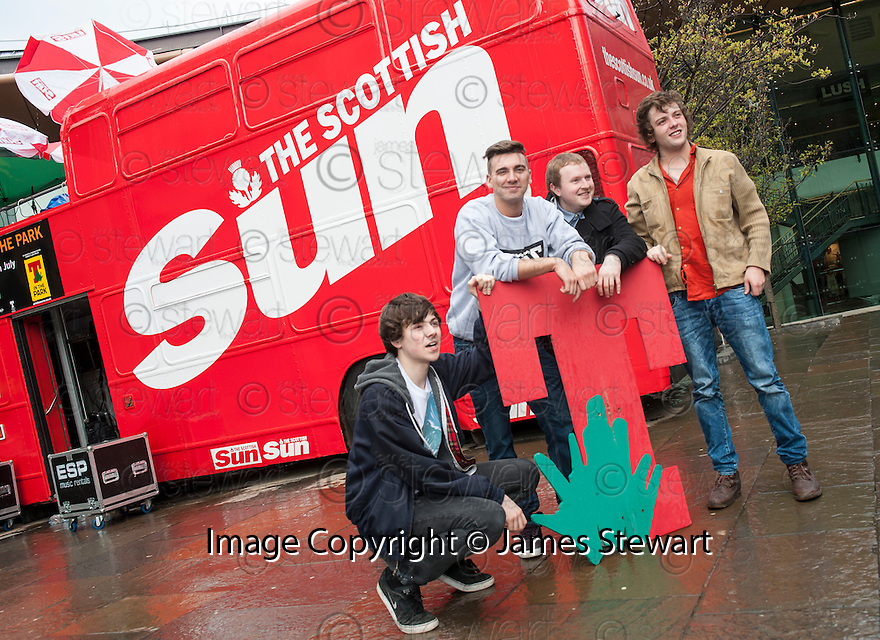 Four of the five members of The LaFontaines who played to rain soaked shoppers from the top of the Sun Bus at The Overgate Centre, Dundee.