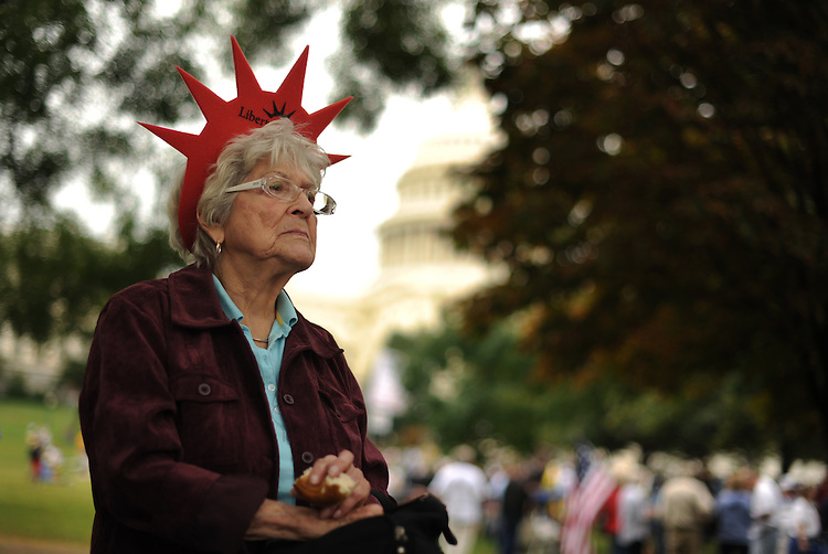 UNITED STATES - SEPTEMBER 12:  Mary Tanner of Florida, listens to  a speaker at a rally on the west front for the 9/12 Taxpayer March organized by FreedomWorks, Tea Party Patriots and other conservative groups. (Photo By Tom Williams/Roll Call via Getty Images)