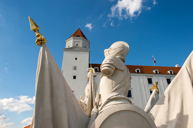 Statues on top of a gate in front of Bratislava Castle on a hill above Bratislava, the capital of Slovakia.