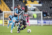 Stanley Aborah of Notts County holds off Paul Hayes of Wycombe Wanderers during the Sky Bet League 2 match between Notts County and Wycombe Wanderers at Meadow Lane, Nottingham, England on 28 March 2016. Photo by Andy Rowland.