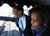 Claymont, DE - January 17, 2009 -- United States President-Elect Barack Obama and Michelle Obama during the first slow roll at Myrtle and Marion Avenues, Claymont, Delaware on the way to Wilmington, Delaware, during Whistle Stop tour on Saturday, January 17, 2009. .Credit: Chang W. Lee - Pool via CNP