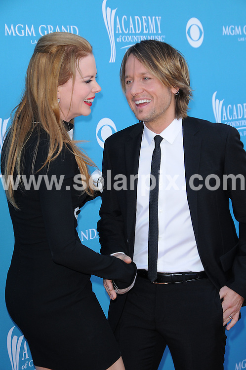 **ALL ROUND PICTURES FROM SOLARPIX.COM**.**SYNDICATION RIGHTS FOR UK, AUSTRALIA, DENMARK, PORTUGAL, S. AFRICA, SPAIN & DUBAI (U.A.E) & ASIA (EXCLUDING JAPAN) ONLY**. 45th Annual Academy of Country Music Awards - Arrivals, MGM Grand Garden Arena, Las Vegas, NV, USA, 18 April 2010.This pic: Nicole Kidman and Keith Urban.JOB REF: 11109     PHZ charlotte    DATE: 18_04_2010.**MUST CREDIT SOLARPIX.COM OR DOUBLE FEE WILL BE CHARGED**.**MUST NOTIFY SOLARPIX OF ONLINE USAGE**.**CALL US ON: +34 952 811 768 or LOW RATE FROM UK 0844 617 7637**