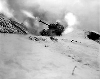 Near Song Sil-li, Korea, a tank of 6th Tank Bn. fires on enemy positions in support of the 19th RCT.  January 10, 1952.  Pfc. Harry M. Schultz.  (Army)<br /> NARA FILE #:  111-SC-389600<br /> WAR &amp; CONFLICT BOOK #:  1438