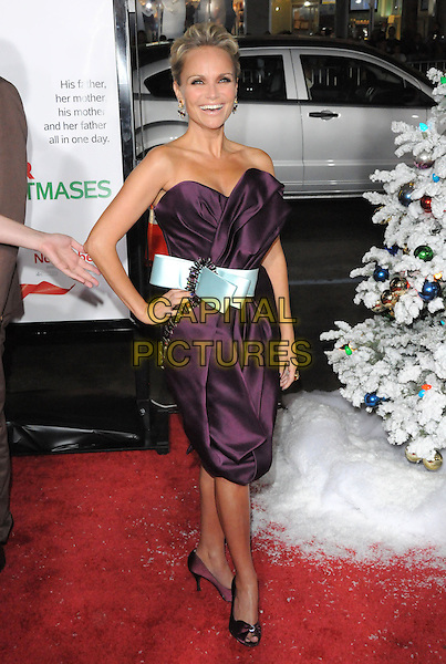 "KRISTIN CHENOWETH.World Premiere of ""Four Christmases"" held at The Kodak Theatre in Hollywood, California, USA..November 20th, 2008                                                                     .4 full length strapless dress purple aubergine blue bow sash ribbon hand on hip.CAP/DVS.©Debbie VanStory/Capital Pictures."