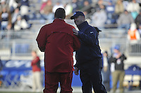 24 November 2012:  Penn State coach Bill O'Brien smiles and talks with Wisconsin coach Bret Bielema before the game. The Penn State Nittany Lions defeated the Wisconsin Badgers 24-21 in OT overtime at Beaver Stadium in State College, PA.